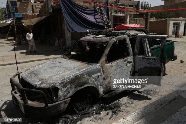 A burnt Police vehicle is pictured after a Taliban attack in Ghazni on August 16 2018 Afghan forces appeared to have finally pushed Taliban fighters...