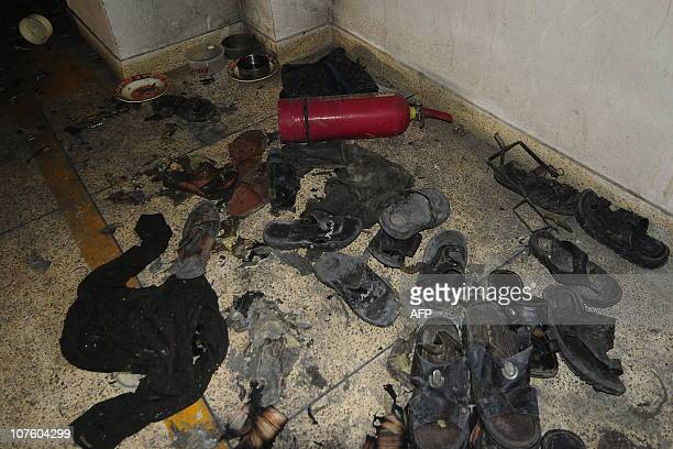 Burnt sandals and tiffin boxes are seen at a dining room on the 10th floor of the Hamim Group garment factory at Ashulia on December 15 2010 A raging...