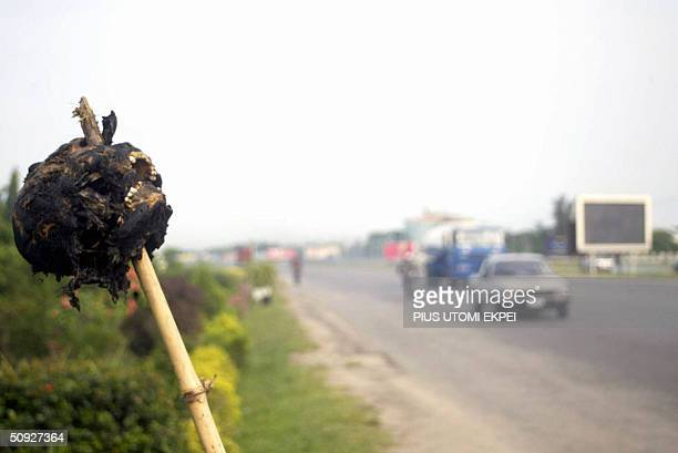 A burnt skull of suspected dealer in human parts hung by the roadside in Niger Delta town of Warri Township 04 June 2004 Security agencies have began...