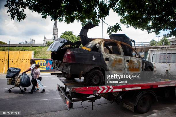A burnt taxi is towed after the police found 'molotov' bombs hidden inside on day 1 of Argentina G20 Leaders' Summit 2018 on November 30 2018 in...