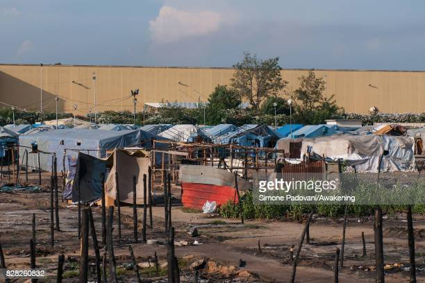 Burnt tents are seen in the old camp after a fire in July that hit the Rosarno ghetto on August 9 2017 in Reggio Calabria Italy The San Ferdinando...