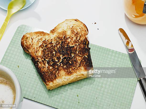 burnt toast - ember stock pictures, royalty-free photos & images