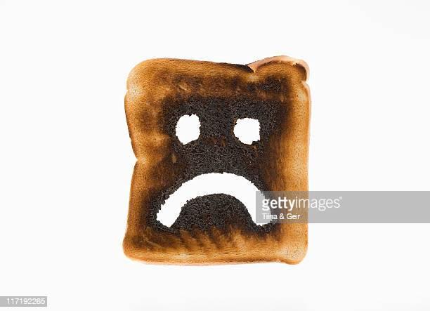 Burnt toast with sad face on it
