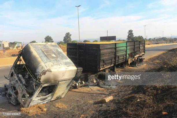 Burnt truck is seen on the side of the road in Manzini, Eswatini, on June 30, 2021. - Demonstrations escalated radically in Eswatini this week as...