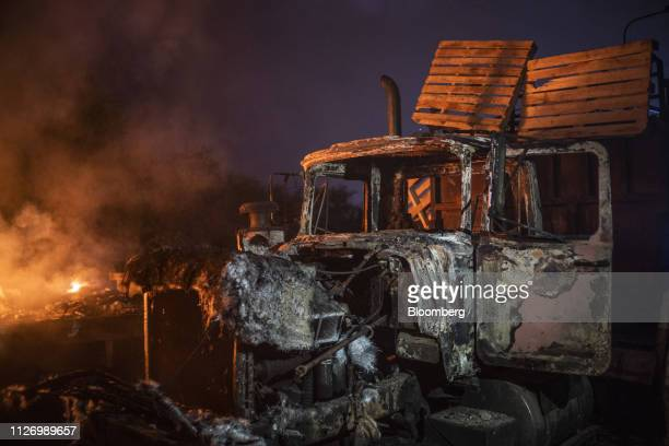 A burnt truck previously loaded with humanitarian aid sits on the Francisco De Paula Santander International Bridge near the border with Venezuela in...