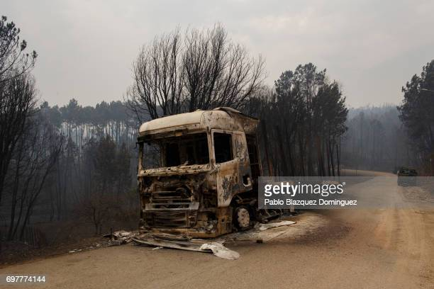 A burnt truck sits on the side of the road after a wildfire took dozens of lives on June 19 2017 near Castanheira de Pera in Leiria district Portugal...