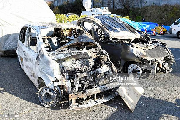 Burnt vehicles are seen after a deadly traffic accident that occurred inside the Hachihonmatsu Tunnel on March 17 2016 in Higashihiroshima Hiroshima...