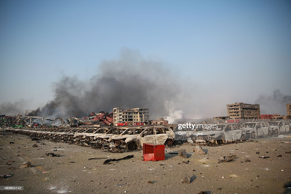 Burnt vehicles are seen in Tianjin's warehouse explosion on August 13, 2015 in Tianjin, China. The death toll from Wednesday warehouse explosions in Tianjin rose to 50 Thursday evening, 17 of whom were firemen, local authorities said.