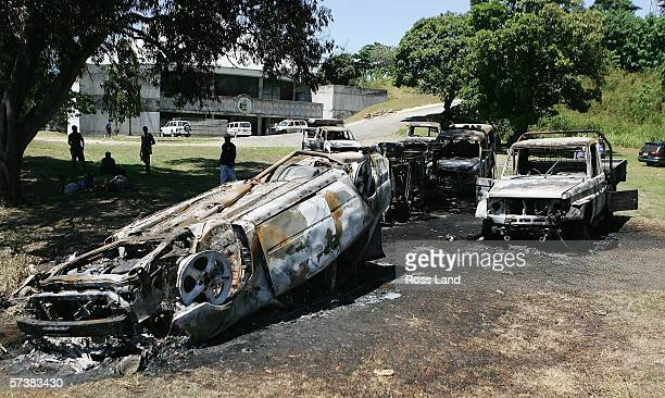 Burnt vehicles lie abandoned in the grounds of Parliament on April 21, 2006 in the Soloman Islands capital of Honiara. Rioters angered by the...