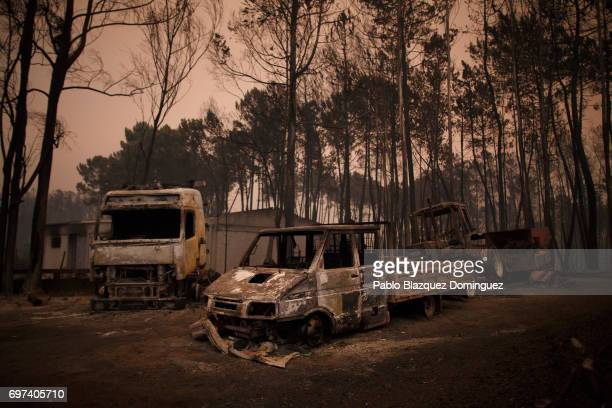 Burnt vehicles stand near the road after a wildfire took dozens of lives on June 18 2017 near Castanheira de Pera in Leiria district Portugal On...