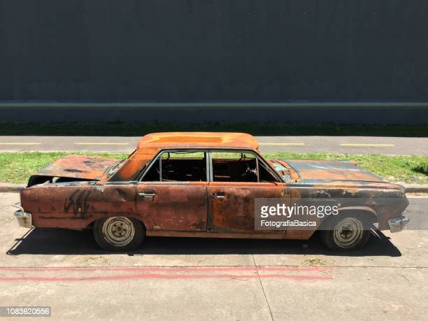 burnt vintage car - car crash wall stock photos and pictures