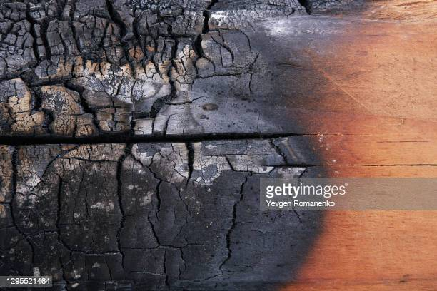 burnt wood texture as a background - burning stock pictures, royalty-free photos & images