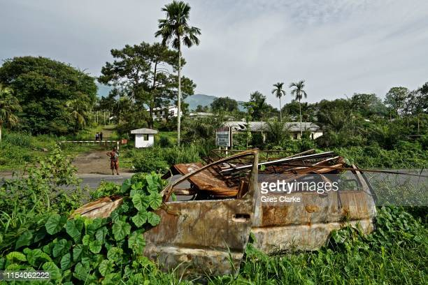 Burnt-out car at the entrance of a former government-owned banana plantation at the entrance of a former government-owned banana plantation on May...