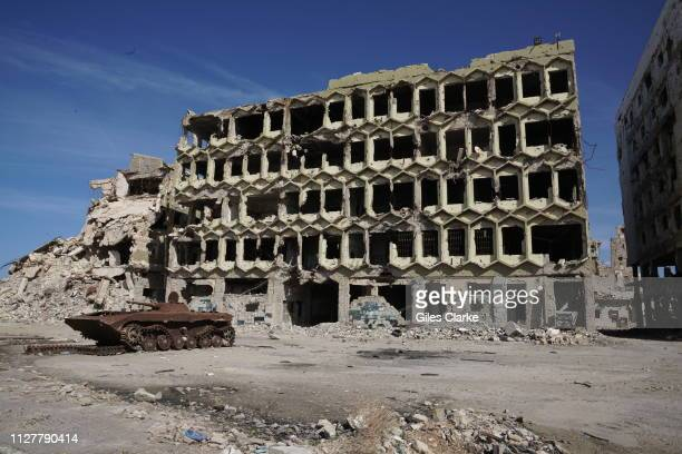 Burnt-out tank outside the former passport office in the now ruined old town of Benghazi on January 31, 2019 in Libya. After the Libyan revolution in...
