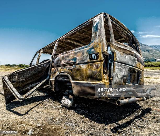 Burnt-out wreck of a passenger mini-bus