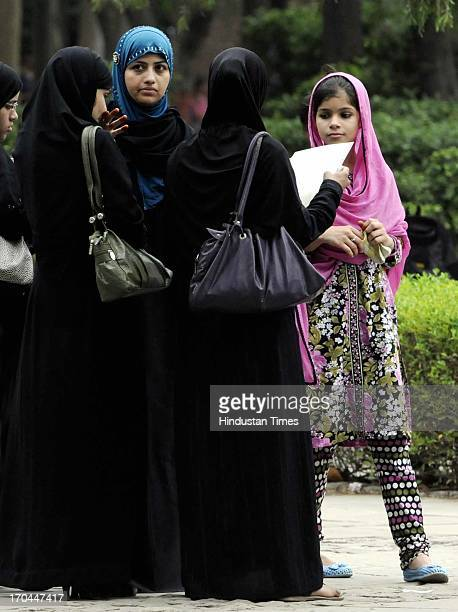 Burqa clad Muslim girls filing their admission forms for fouryear undergraduate programme at the Arts Faculty at North Campus on June 13 2013 in New...