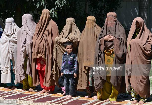 Burqaclad female supporters of Pakistani Prime Ministerelect and head of the Pakistan Muslim LeagueN Nawaz Sharif offer special prayers as they...