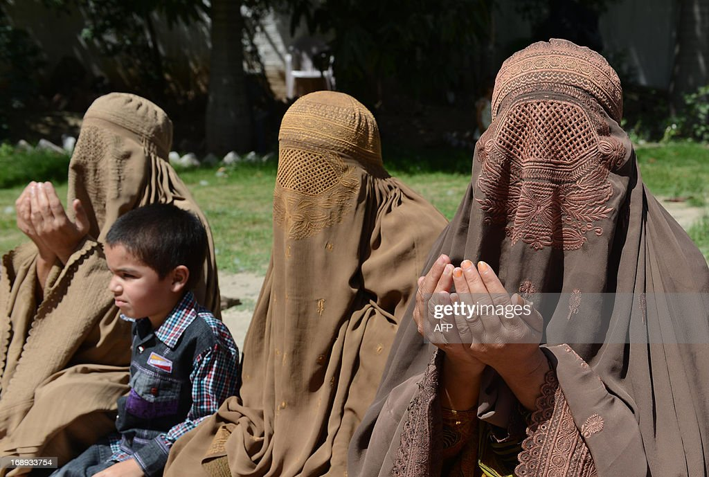 Burqa-clad female supporters of Pakistani Prime Minister-elect and head of the Pakistan Muslim League-N (PML-N) Nawaz Sharif offer special prayers as they observe the 'thanks giving day' on the victory of their party in landmark general elections, in Peshawar on May 17, 2013. Partial official results confirm PML-N on 123 seats, with the outgoing Pakistan People's Party on 31 and PTI on 26. Another 18 of the 272 directly elected seats in the national assembly are still to be declared.