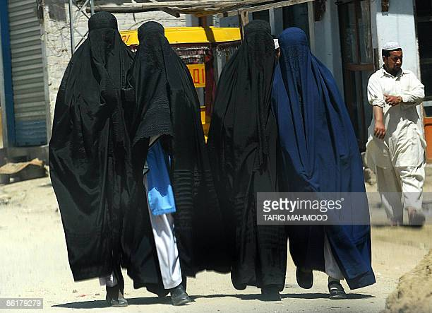 Burqaclad Pakistani school students walk home after a day at school in Buner district of the troubled Swat valley on April 23 2009 Pakistan deployed...