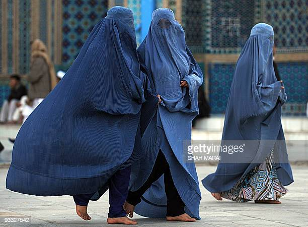 Burqaclad women walk at the Hazrat Ali Shrine in the northern town of MazariSharif in Balkh province on March 19 2009 Tens of thousands of Afghans...