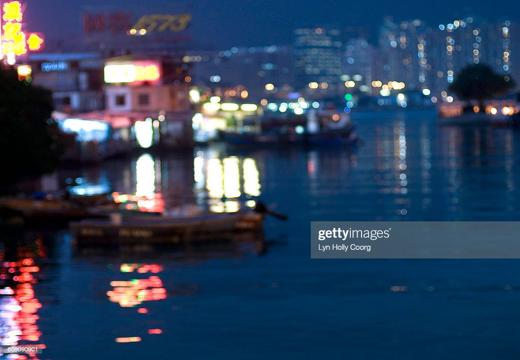 Burred lights reflected in harbour water : Stock Photo