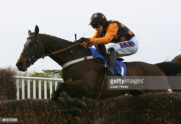 Burren Legend ridden by Paddy Brennan jumps a fence and goes on to land the The 3663 First For Food Service Novices' Steeple Chase run at Fontwell...