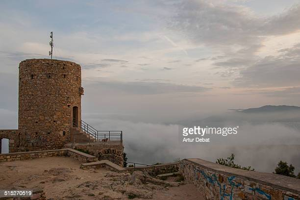 Burriac castle with nice view from above of the clouds in the Maresme region Catalonia Europe