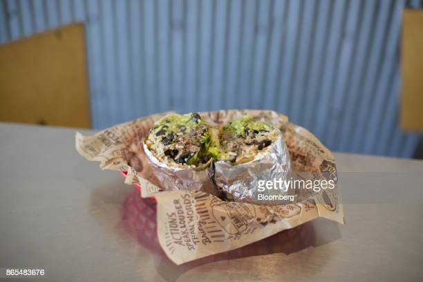 A burrito is arranged for a photograph at a Chipotle Mexican Grill Inc restaurant in Tempe Arizona US on Saturday Oct 21 2017 Chipotle Mexican Grill...