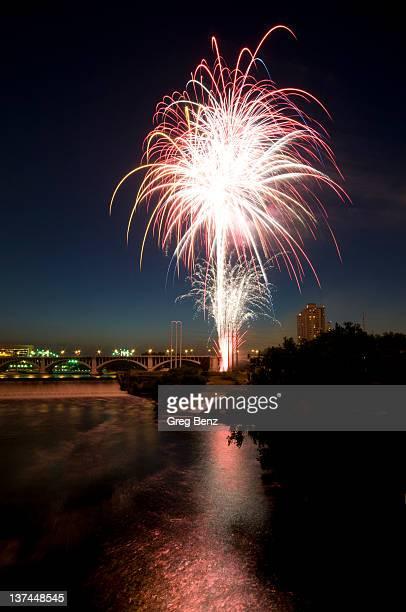 Burst of fireworks explode in dark blue sky