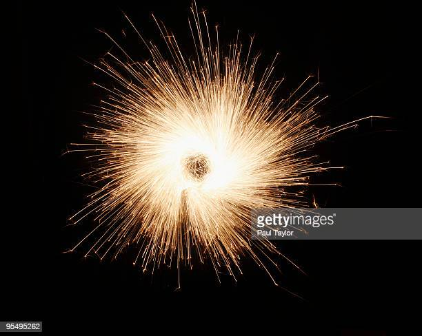 burst of sparks - sparks stock pictures, royalty-free photos & images