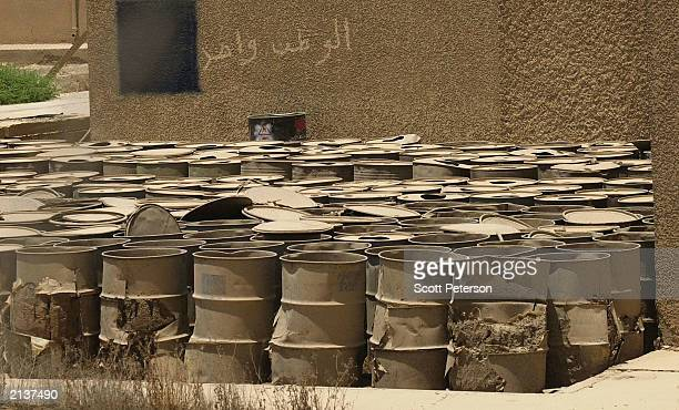 Bursting and rusting barrels stand outside a USprotected Iraqi facility for storing yellowcake one product of the uranium enrichment process for...