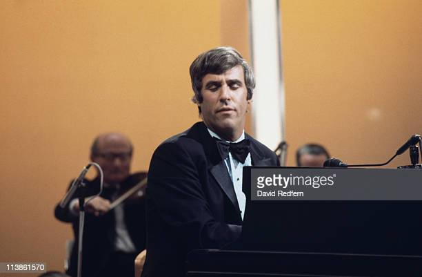 Burt Bacharach US pianist and songwriter playing the piano during a live concert performance circa 1975