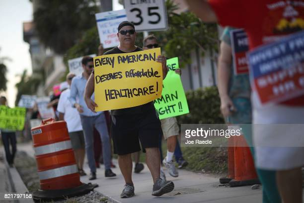 Burt Boice joins with other protesters against Republican senators who have not spoken up against Affordable Care Act repeal and demand universal,...