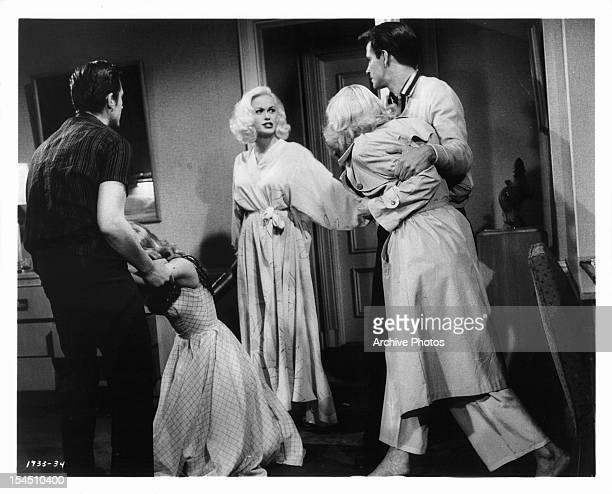 Burt Douglas holds Jan Sterling while Mamie Van Doren watches Diane Jergens being held back by John Drew Barrymore in a scene from the film 'High...