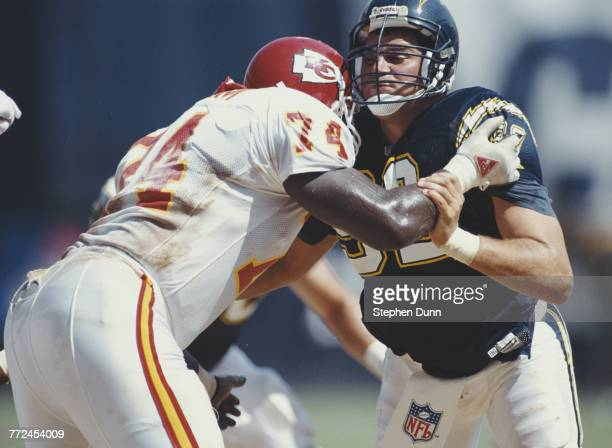 Burt Grossman Defensive End for the San Diego Chargers blocks Derrick Graham Guard for the Kansas City Chiefs during their American Football...