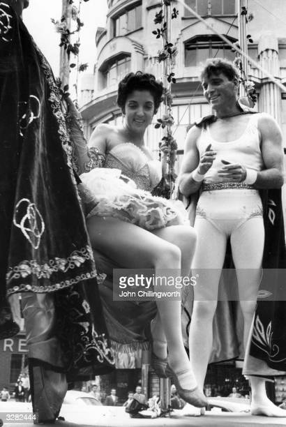 Burt Lancaster and Katy Jurado taking part in a circus parade through the streets of Paris which was organised by the producers as a publicity stunt...