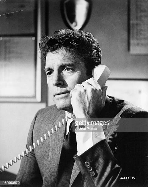 Burt Lancaster holds a phone in a scene from the film 'Airport' 1970