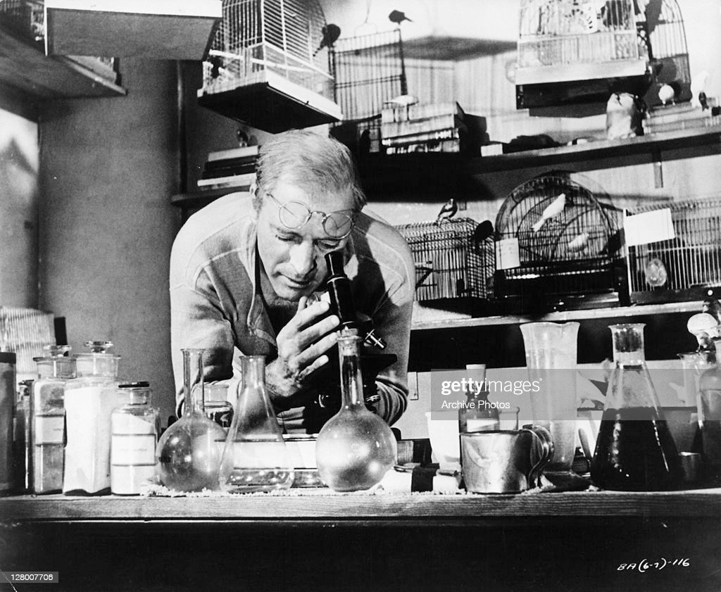 Burt Lancaster looking through microscope in a scene from the film... News  Photo - Getty Images