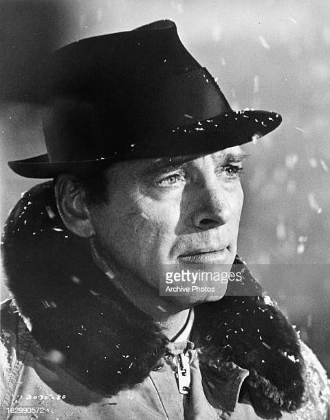 Burt Lancaster stands in the snow in a scene from the film 'Airport' 1970
