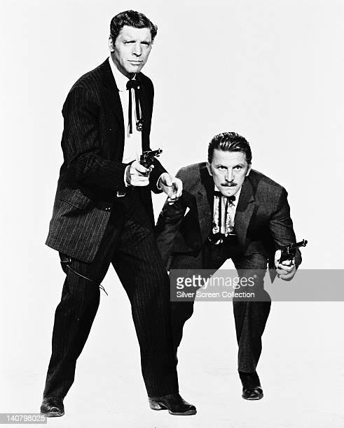 Burt Lancaster US actor and Kirk Douglas US actor both in costume and holding pistols in a publicity portrait issued for the film 'Gunfight at the OK...