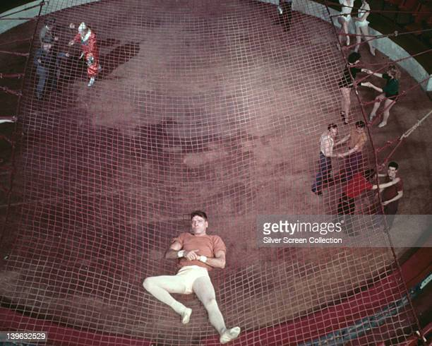 Burt Lancaster US actor reclining on a safety net in a publicity still issued for the film 'Trapeze' USA 1956 The circus drama directed by Carol Reed...