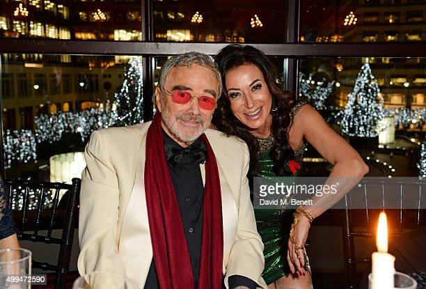 Burt Reynolds and Nancy Dell'Olio attend The Snow Queen Cigar Smoker of the Year Awards Dinner 2015 at Boisdale Canary Wharf on December 1 2015 in...