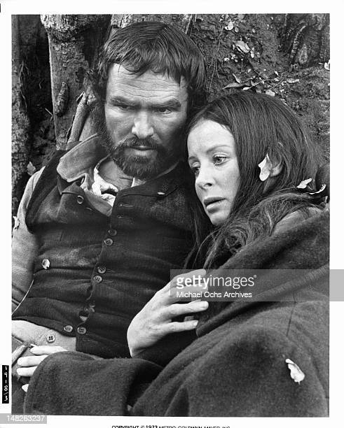 Burt Reynolds and Sarah Miles huddled together in a scene from the film 'The Man Who Loved Cat Dancing' 1973