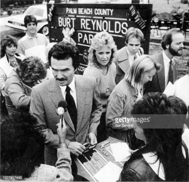 Burt Reynolds talks with fans and reporters after the dedication ceremonies changing Jupiter Island Park to Burt Reynolds Park in December 1985