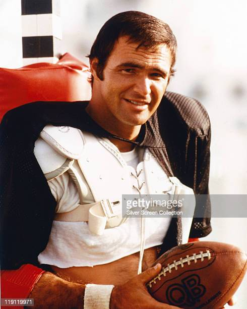 Burt Reynolds US actor holding an American football and wearing shoulder pads in a publicity still issued for the film 'The Mean Machine' USA 1974...