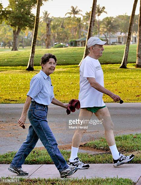 Burt right and Ellie Landy get their morning exercise May 15 during their 32 mile walk around the Granada Golf Course in Coral Gables Florida