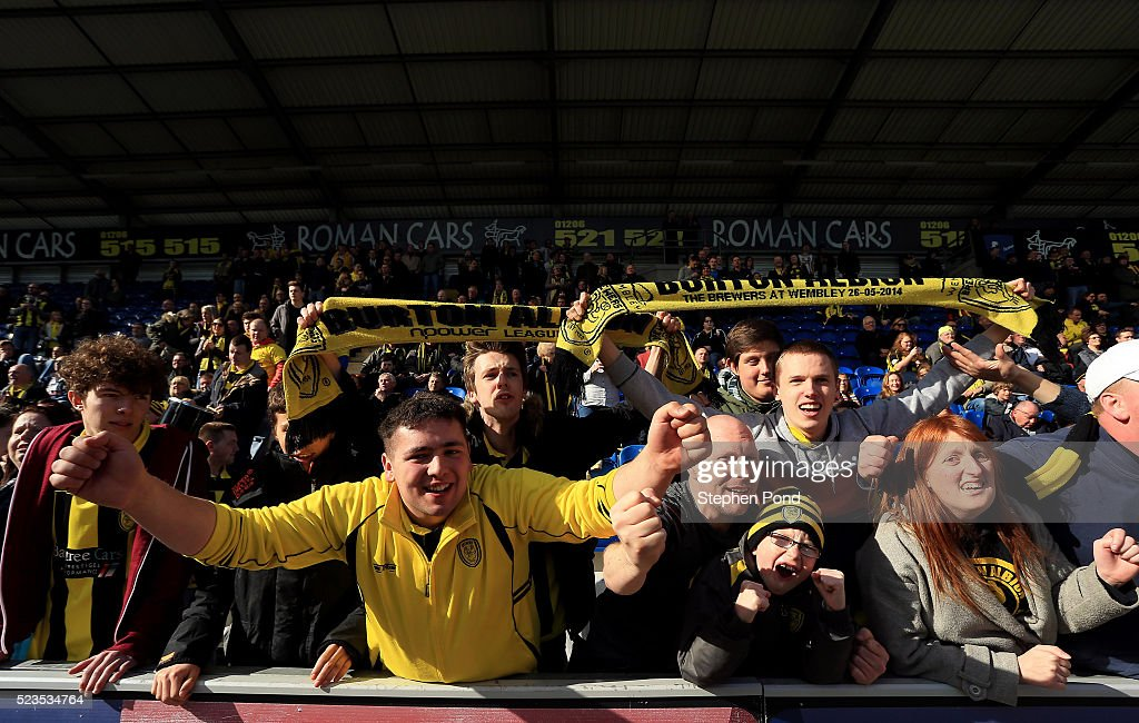 Burton Albion fans celebrate victory during the Sky Bet League One match between Colchester United and Burton Albion at Colchester Community Stadium on April 23, 2016 in Colchester, England.