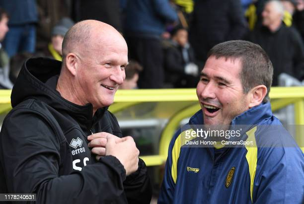 Burton Albion manager Nigel Clough greets Blackpool manager Simon Grayson during the Sky Bet League One match between Burton Albion and Blackpool at...