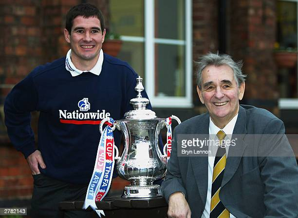 Burton Albion Player/Manager Nigel Clough and his legendary father Brian pose with the FA Cup at the Holy Trinity Primary School on December 4 2003...