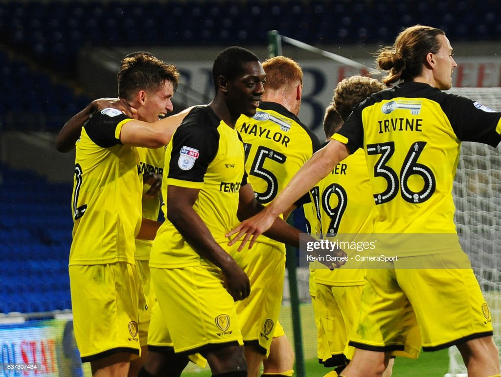 Burton Albion's Ben Fox (left) celebrates scoring his sides second goal during the Carabao Cup Second Round match between Cardiff City and Burton Albion at Cardiff City Stadium on August 22, 2017 in Cardiff, Wales.
